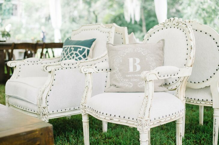 Antiqued chairs and printed pillows struck the perfect balance of vintage and modern.