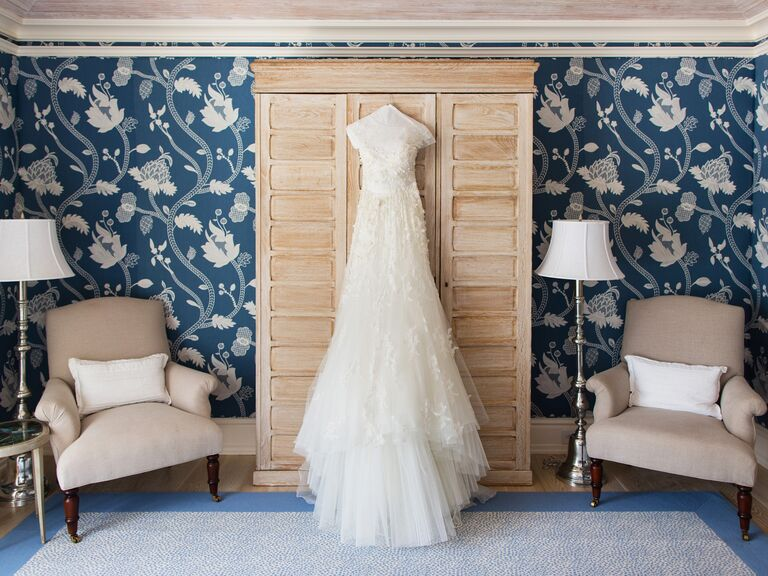 A-line wedding gown on hanger