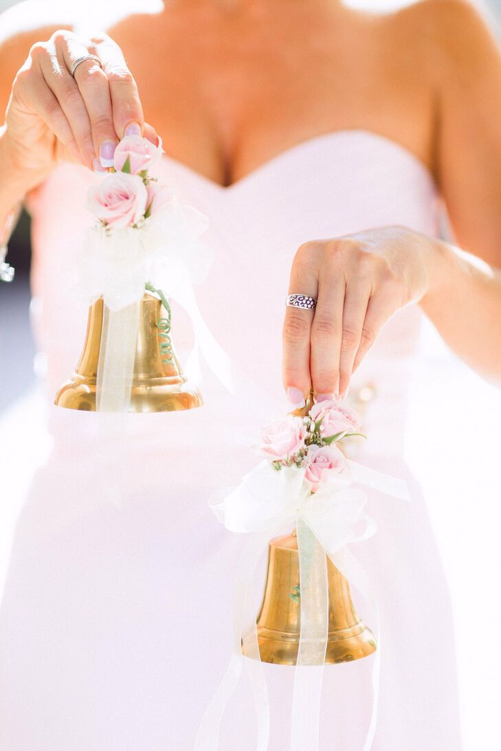 The flower girls carried small decorated bells for their walk down the aisle.