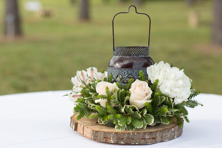 Rustic lantern centerpiece with rose halo