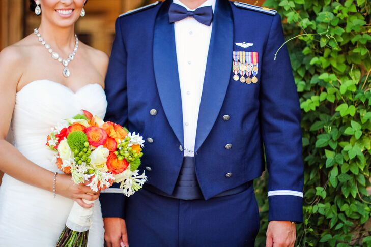 Todd wore his formal military blues, which he and Rebecca paired with coral orange flowers and bright greens in their palette.