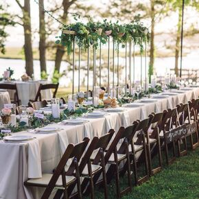 Outdoor Reception With Kings Table And Wood Chairs