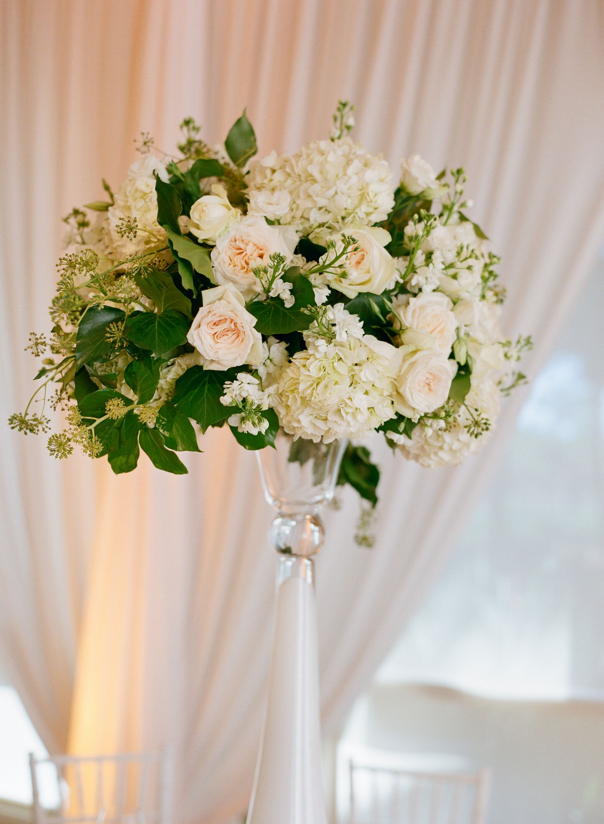 Hydrangea garden rose and greenery accented centerpiece