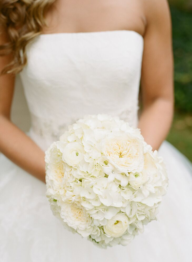 To complement her timeless bridal style, the florists at Flowers on the Vineyard created a lush, ivory bouquet filled with romantic full blooms like garden roses, freesia, ranunculuses and hydrangeas for Caity to carry down the aisle. The bridesmaids carried similar arrangements in soft shades of blush and ivory that popped against their navy gowns.