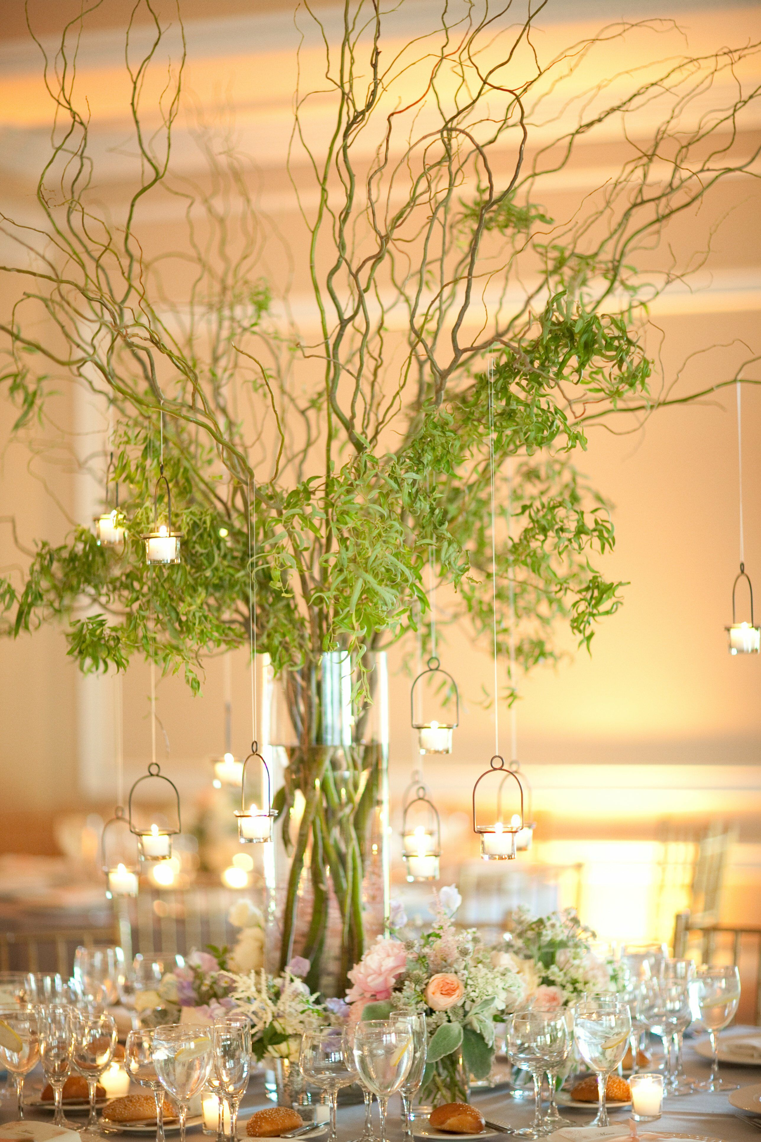 Vine centerpieces with hanging votive candles for Table and vine