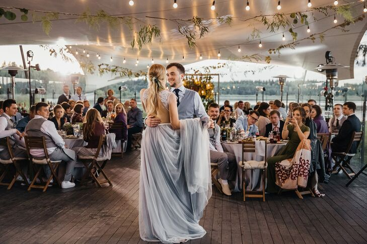 """Our first dance was simple and romantic,"" Katya says of dancing to Frankie Valli's ""Can't Take My Eyes Off You"" with Nikita at Shishki Hotel in Zagorshchnya, Belarus."