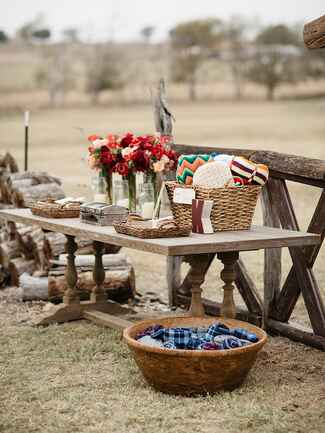 Cozy blankets for a rustic camp wedding