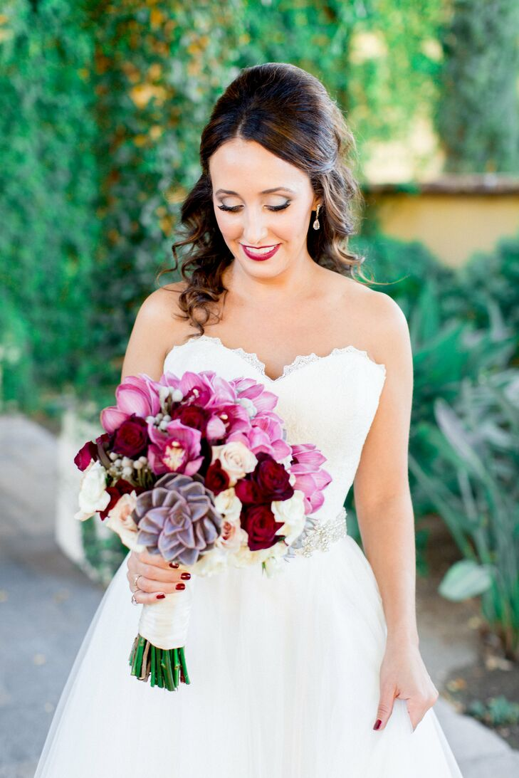 bright colorful bridal bouquet with succulents and crimson blossoms