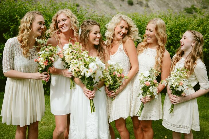 Bridesmaids wore mismatched ivory lace gowns so that the entire party gave off a bohemian vibe.