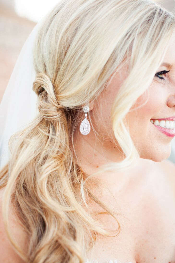 Courtney wore silver teardrop earrings accented with crystals, which she borrowed from her mother. The earrings added an elegant touch to her wedding day ensemble.