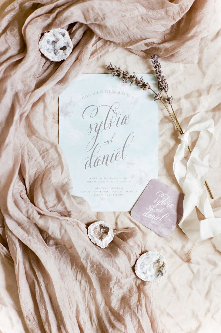 Drawing inspiration from their West Coast theme, Sylvia and Daniel chose an elegant watercolor design for their invitations in soft pastel hues from Wedding Paper Divas. For the programs, place cards and other signage, the pair went for a more formal look and harnessed Daniel's design skills to pull it all together.