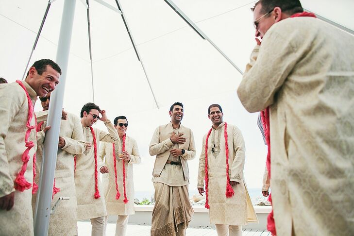 The groom wore a Tarun Tahiliani dhoti and jacket while his groomsmen rocked cream-colored kurtas with bright red scarves.