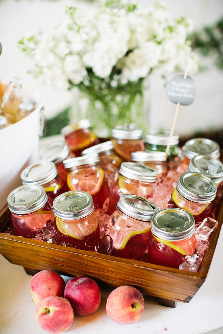 As guests arrived at the urban garden ceremony, Nicole and Tom served mason jars filled with raspberry- and lemon-infused water along with colorful sodas. The couple wanted their guests to be refreshed and content during the nuptials.