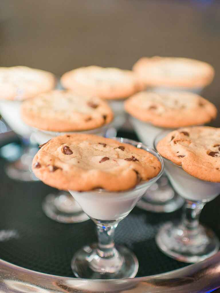Glasses of milk with chocolate chip cookies for a wedding reception food idea