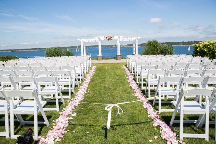 The ceremony decor was kept simple, yet romantic, allowing the beauty of the setting to shine through. Golden Gate Studios lined the aisle with pale pink and white rose petals and added a lush lavender, pink and white arrangement to the elegant trellis under which the couple exchanged vows.