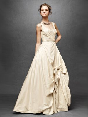 New anthropologie launches a bridal line bridal fashion theres something so sophisticated about this scoop neck wedding dress accented with a soft bow on the skirt junglespirit Image collections