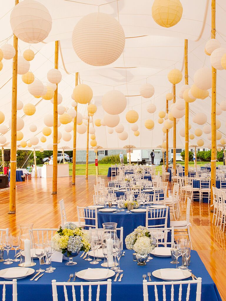Tented wedding reception with white and yellow paper lanterns