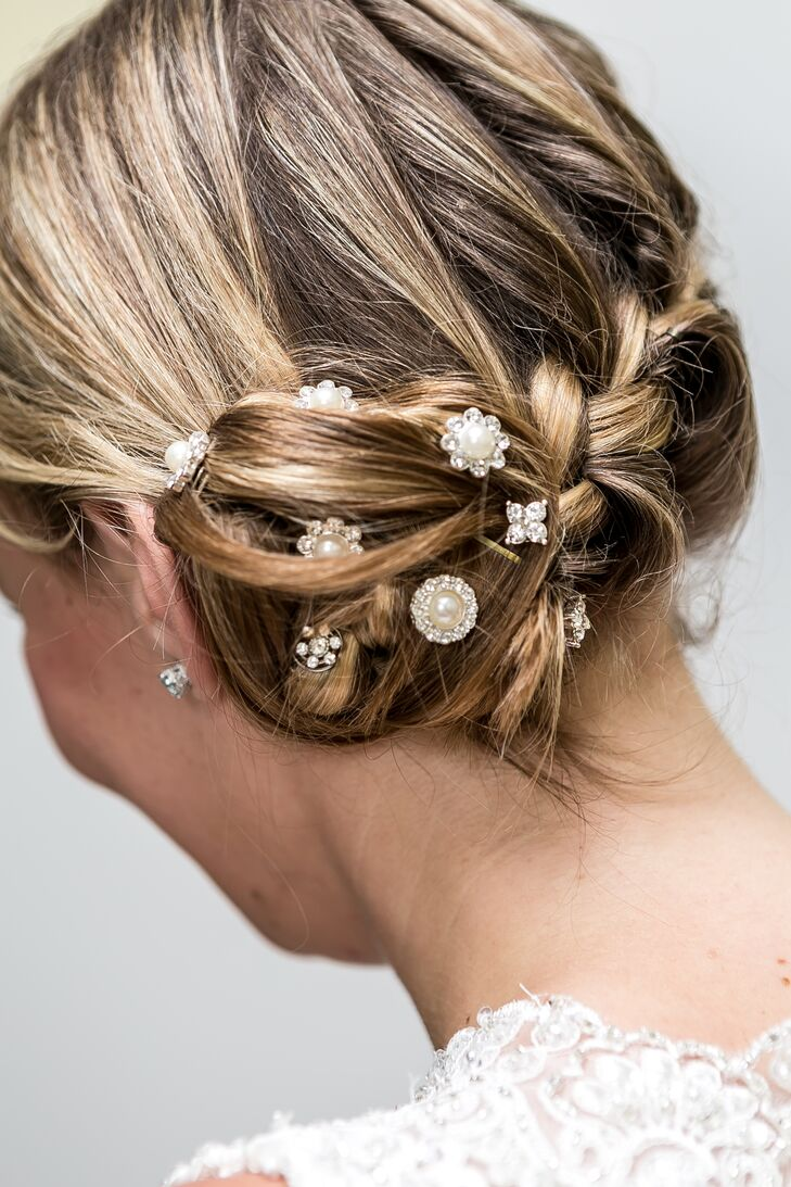 Megan wore her hair in an intricate updo with crystal and pearl accents woven in.
