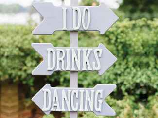 I Do, Drinks and Dancing directional sign at wedding reception
