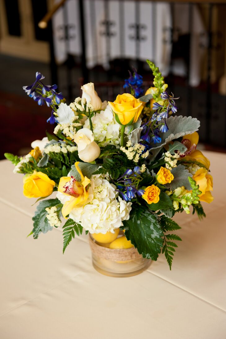 Rose hydrangea orchid and lemon centerpiece