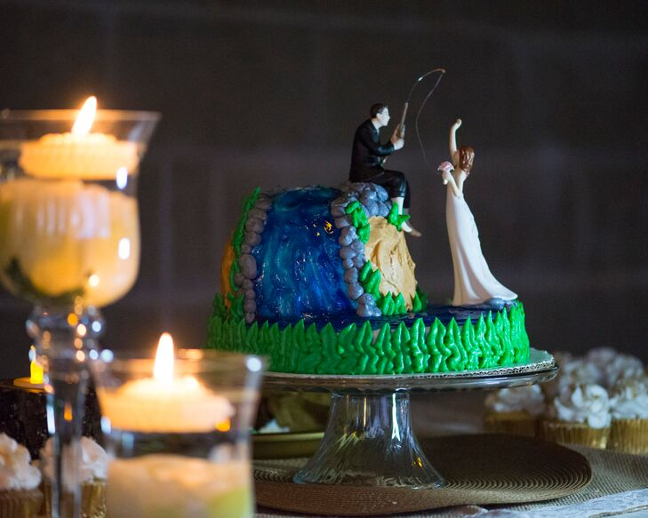 """Our cake embodied our love of fishing,"" Larrissa says. ""It was the most personalized touch we added. We are avid crappie fishers, and our two-tier cake was of a man fishing and catching his bride."""