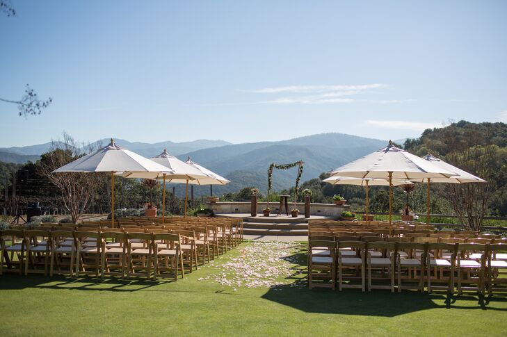 """Our wedding was held at the top of a hill at Holman Ranch Vineyards, in the midst of the rolling green hills of Carmel Valley, California,"" Jamie says. ""Our entire wedding was held outdoors, where Jeff and I both love to be. We are outdoors people, so this beautiful setting was perfect for us."""