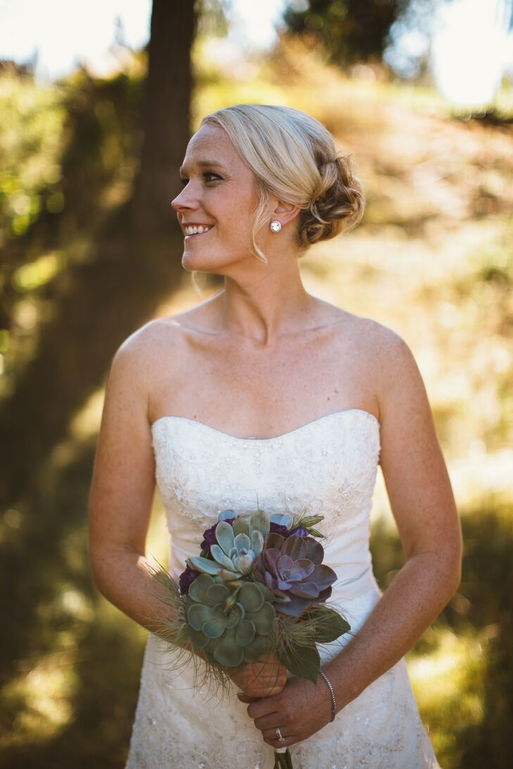 Bethany held a bridal bouquet made up of lush succulents, which she and Lucas wanted to incorporate into the wedding day decor from the start.