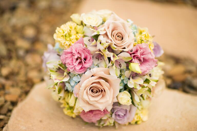 Pastel bridal bouquet with roses and hydrangeas