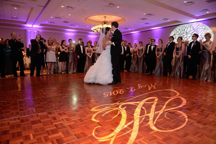"Amanda and Chris danced to one of their favorite songs, ""Crazy Love"" by Van Morrison, performed by their 10-piece jazz band, Men of Distinction. Their monogram and wedding date lit up the dance floor."