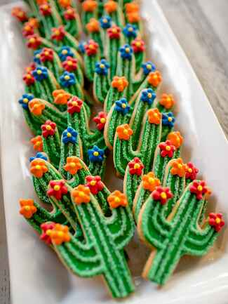 Decorated cactus-themed sugar cookies wedding dessert
