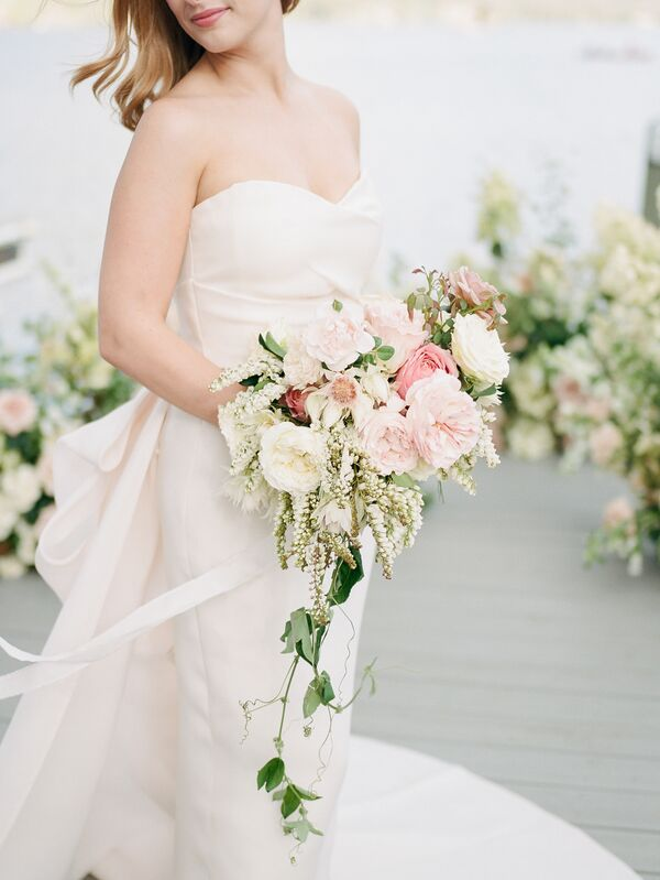 Pink wedding bouquets blush gown complemented by pink and ivory bouquet mightylinksfo