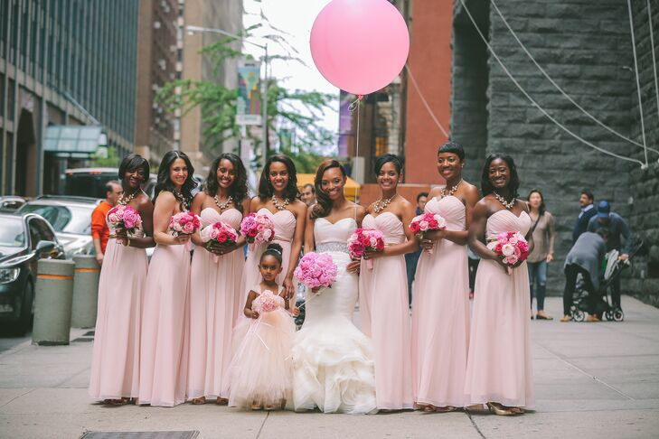 The bridesmaids wore blush sweetheart neckline chiffon dresses with pearl statement necklaces, a gift from the bride.