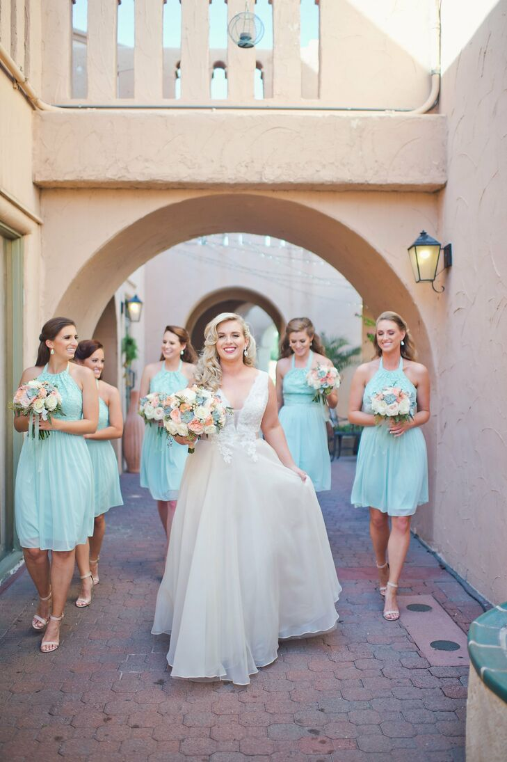 "To keep with a central goal of comfort, Liz chose knee-length dresses. ""I opted for knee-length dresses that I knew my girls would be able to dance in all night. After the ceremony, they quickly changed from their nude heels to white Keds sneakers."""