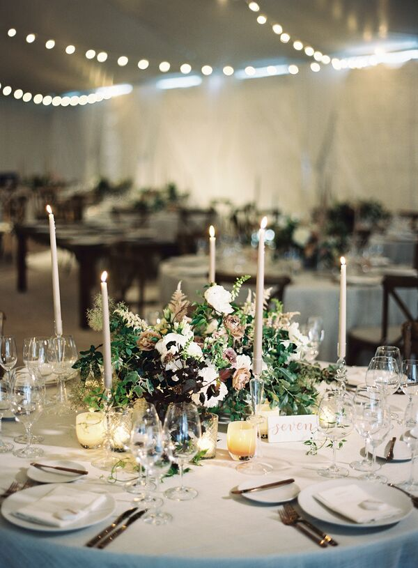 Rustic Wildflower And Taper Candle Centerpiece