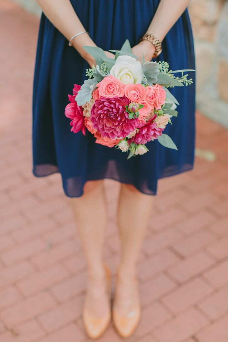 Bridesmaids carried bouquets with a variety of coral-toned flowers, including spray roses, garden roses, dahlias, succulents, dusty miler and eucalyptus.