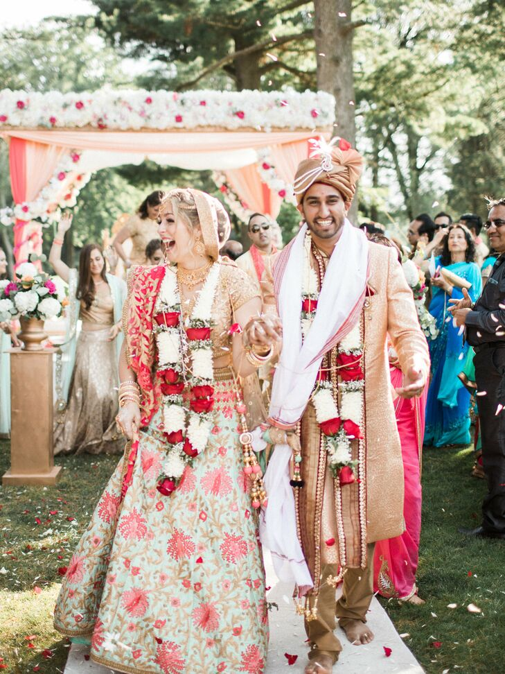 """We wanted our wedding to bring our two sides of the family together so that affected every decision we made,"" says Arselie. One of those decisions was to have customized programs at both the Catholic and Hindu ceremonies so each side could follow what was happening."