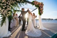 """We knew we wanted the wedding to be at a beach-type venue, because we love the outdoors and because many of our out-of-town guests were coming from t"