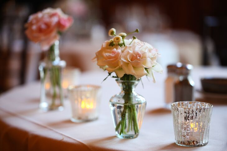 Spray Rose Centerpiece In Bud Vases With Tea Light Candles
