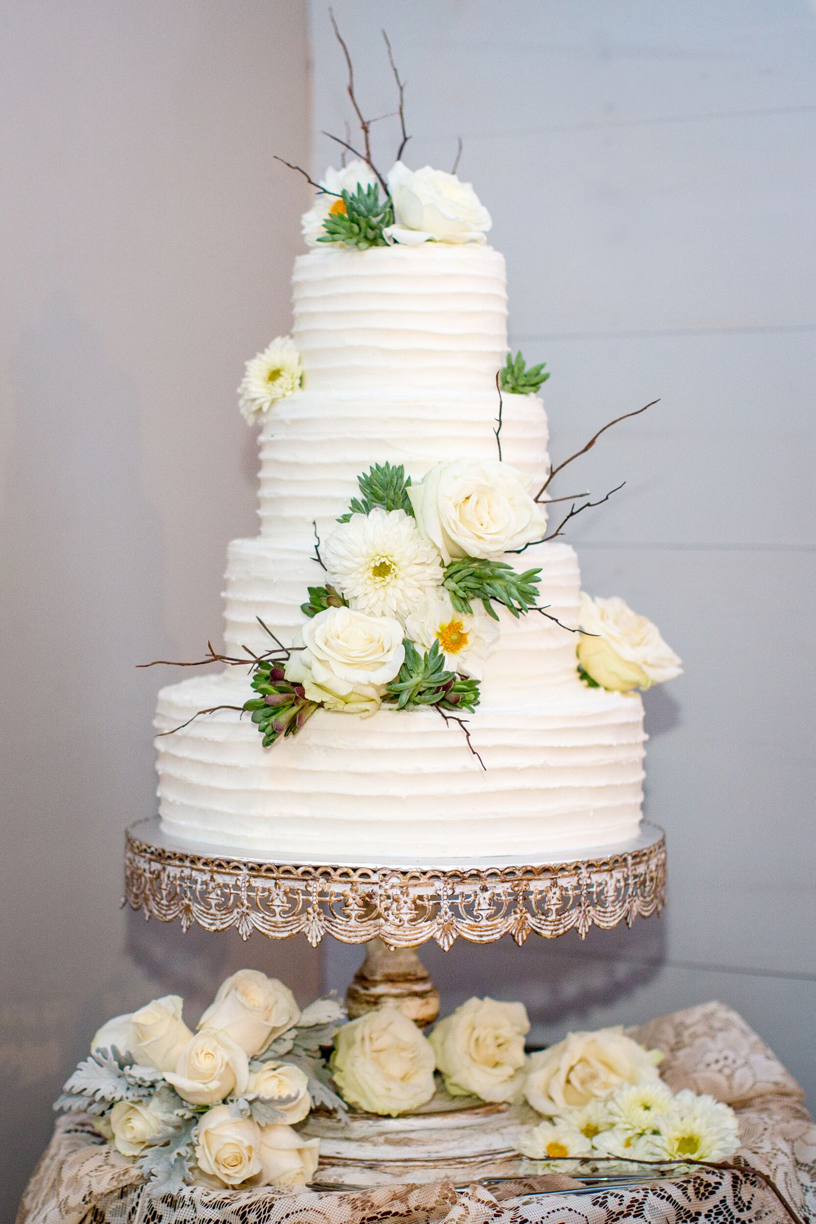 Ivory Wedding Cake With Roses And Daisies