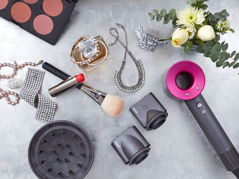 Dyson hairdryer, makeup brush, lipstick and jewelry