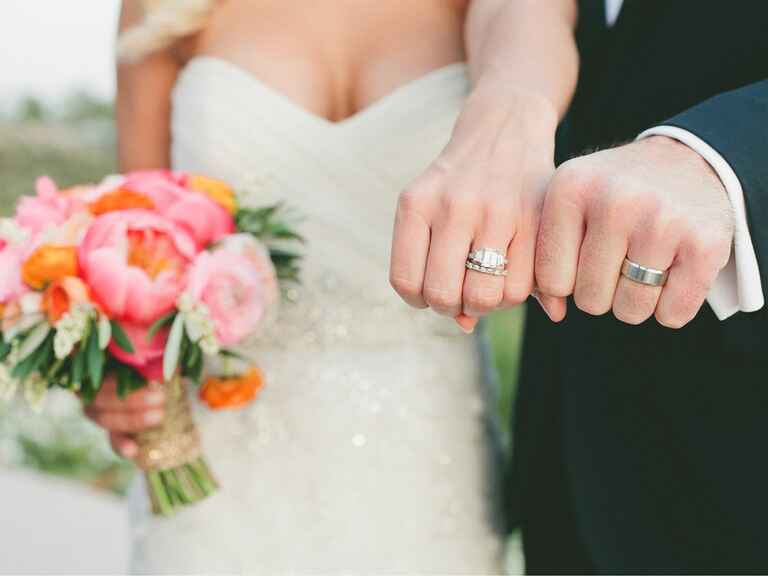 newlyweds showing wedding rings