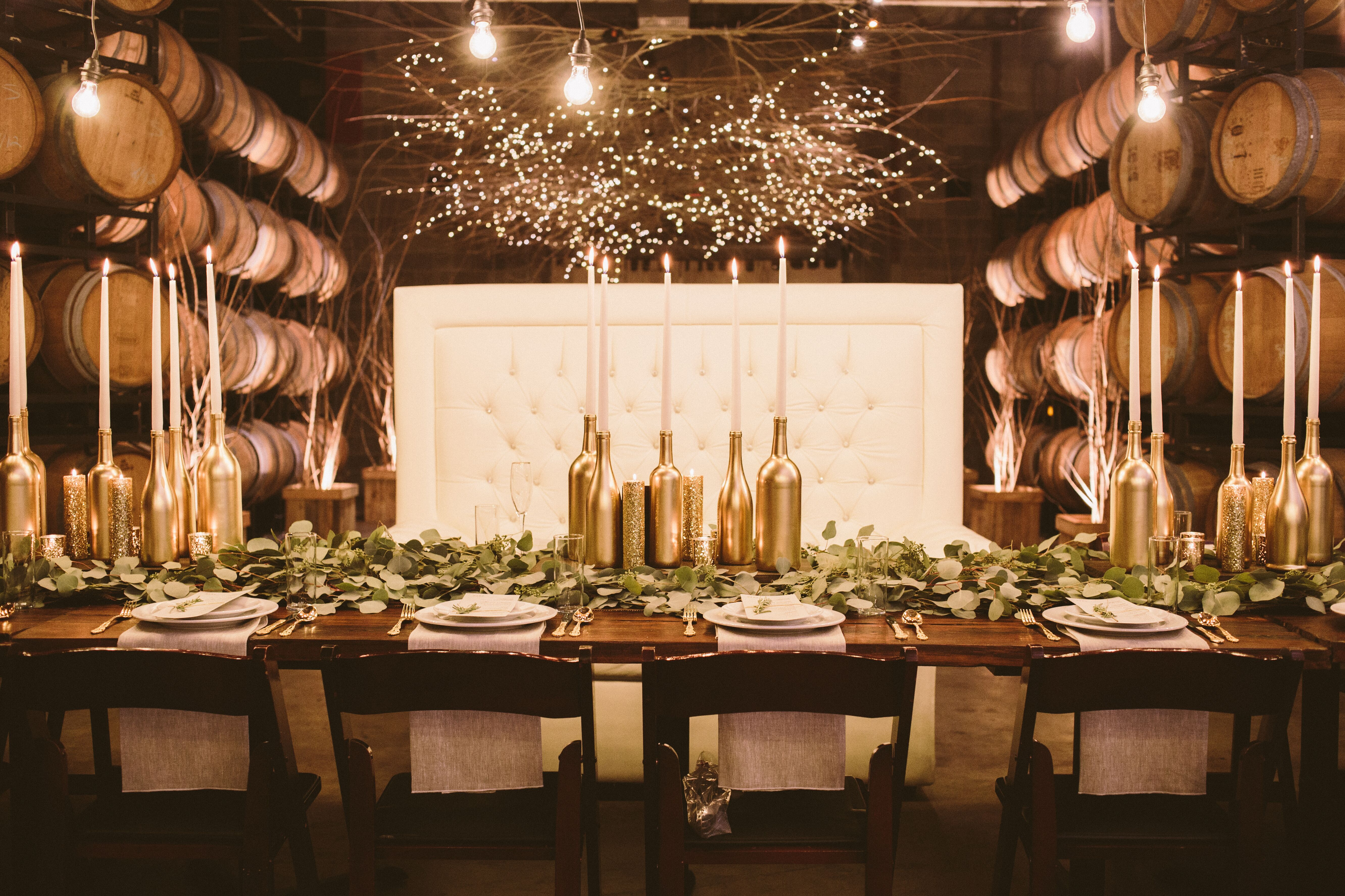 Diy gold wine bottle candlesticks centerpieces for Wine and paint orlando