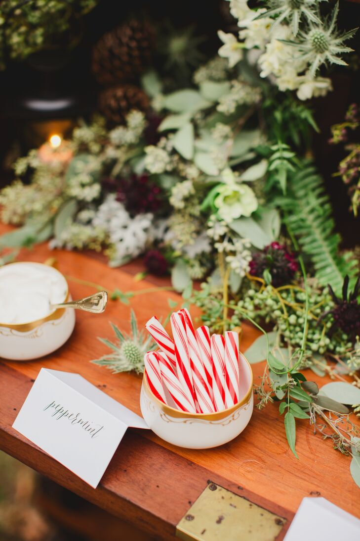 The hot chocolate bar was decked out in fresh flowers, greenery and berries.