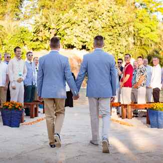 Two grooms beach wedding