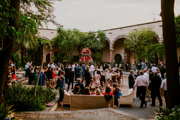 Before sitting down to a four-course meal of fresh, seasonal eats, the newlyweds and their guests enjoyed cocktail hour in Instituto Allende's lush courtyard. Guests sipped on local tequilas and were treated to a spread of bite-size eats and hand-rolled cigars.