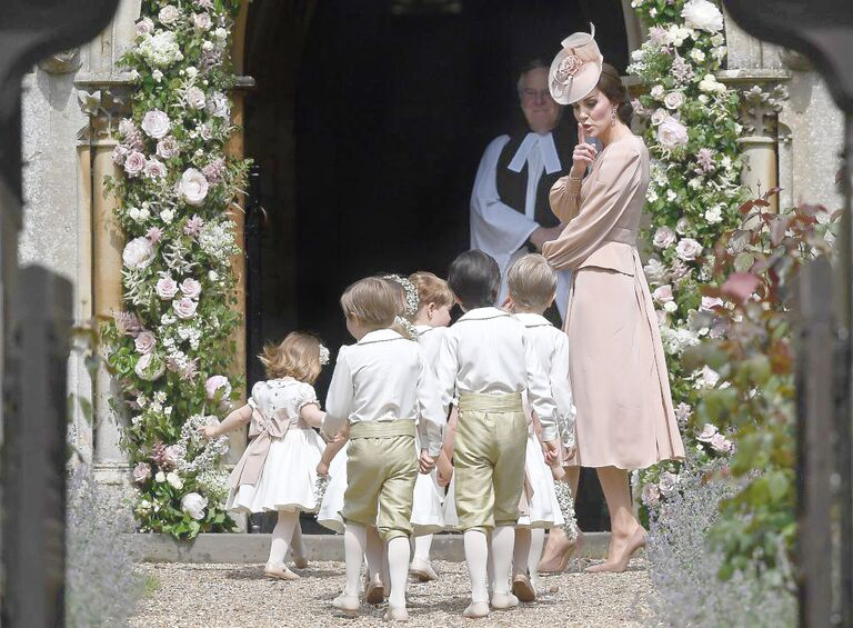 Duchess Kate shushing pageboys and flower girls at Pippa Middleton's wedding