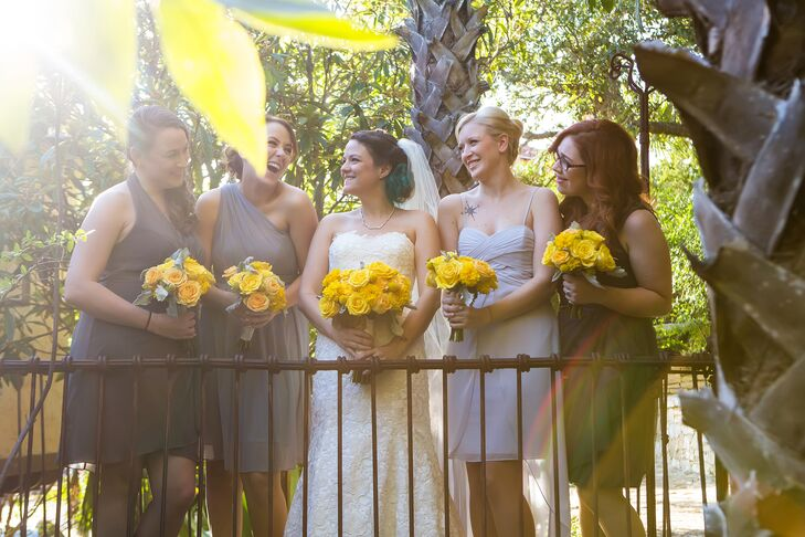 Lauren loves the eclectic dress trend and wanted each bridesmaid to find a dress to suit her body type and complexion, so she let each of her bridesmaids choose their own gray dress.
