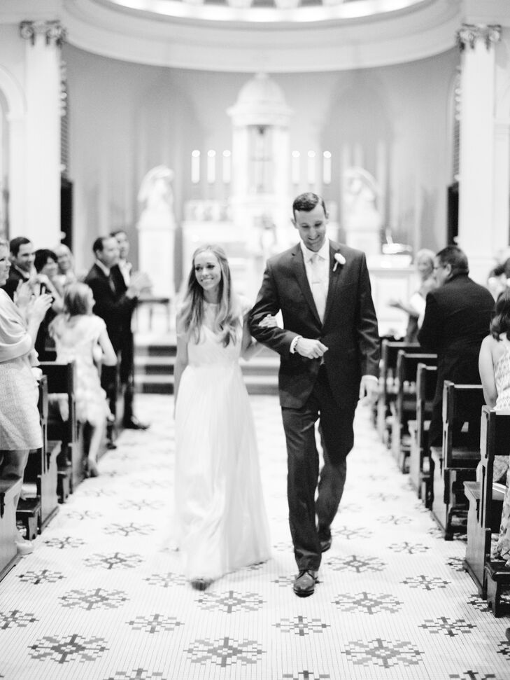 Married Couple Walking Down Aisle