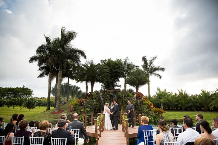 About 100 guests watched from white chiavari chairs as Lupe and Alejandro were wed overlooking Longan's Place's waterfall.