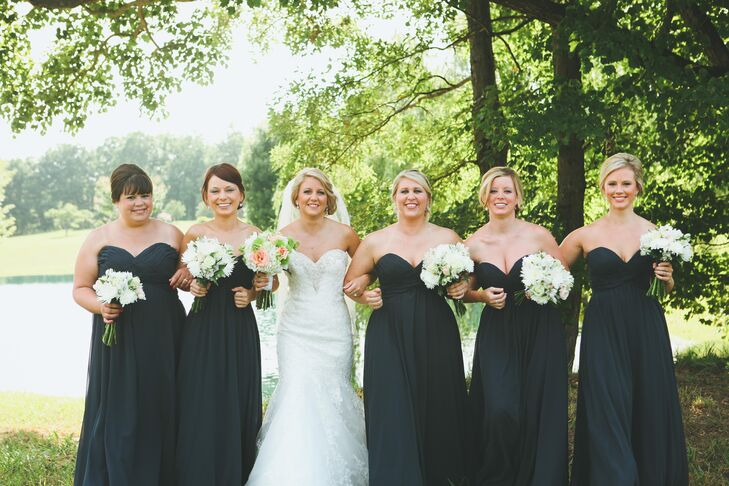 "The bridesmaids paired their long, navy chiffon dresses with coral heels. ""Their dress had a whimsical look to it and was very pretty on each body type!"" says Ansley."